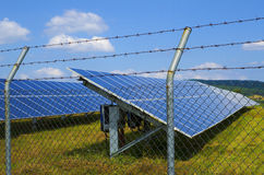 Couple of solar panel fenced in a rusty barbed wire. Near Sofia stock images