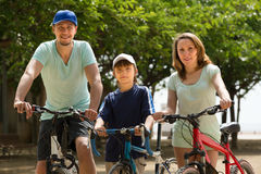 Couple with son on bicycles Royalty Free Stock Photo