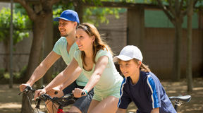 Couple with son on bicycles Stock Photo