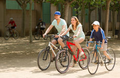 Couple with son on bicycles Royalty Free Stock Photos