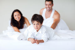 Couple and son enjoying together in bed Royalty Free Stock Photography