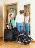 Couple with  son with luggage near door Stock Image