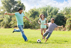 Couple with son playing with soccer ball Stock Photography