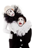 A couple sorrowful clowns isolated. A couple sorrowful clowns, white background stock images