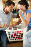 Couple Sorting Laundry In Kitchen Royalty Free Stock Photography