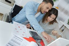 Couple sorting out finances. Couple stock photo