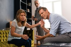 Couple sorting out relationship during the therapy session royalty free stock photo