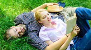 Couple soulmates at romantic date. Romantic couple students enjoy leisure with poetry or literature grass background. Couple in love spend leisure reading book royalty free stock photography