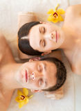 Couple in spa. Picture of couple in spa salon lying on the massage desks stock images