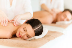 Couple in spa. Health and beauty, resort and relaxation concept - couple in spa salon getting massage stock images