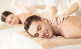 Couple in spa. Healthcare and beauty concept - picture of couple in spa salon getting massage Stock Images
