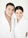 Couple in spa. Healthcare and beauty concept - picture of couple in spa salon in white bathrobes royalty free stock photography