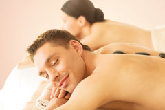 Couple in spa with hot stones Royalty Free Stock Photography