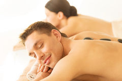 Couple in spa with hot stones Royalty Free Stock Images