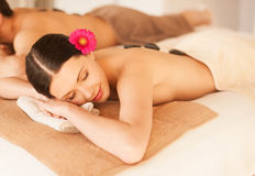 Couple in spa with hot stones Royalty Free Stock Image