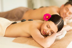 Couple in spa with hot stones. Picture of couple in spa salon with hot stones Royalty Free Stock Photo