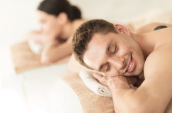 Couple in spa with hot stones Stock Image