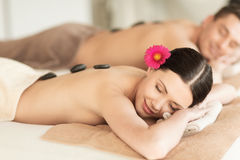 Couple in spa with hot stones Stock Photography