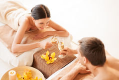 Couple in spa. Picture of couple in spa salon drinking champagne royalty free stock image