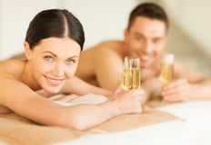 Couple in spa. Picture of couple in spa salon drinking champagne royalty free stock photography