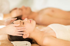 Couple in spa. Picture of couple in spa salon getting face treatment Stock Image