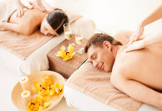 Couple in spa. Picture of couple in spa salon getting massage Royalty Free Stock Photos