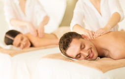 Couple in spa. Picture of couple in spa salon getting massage stock photos