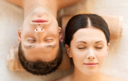 Couple in spa. Picture of couple in spa salon lying on the massage desks stock image