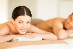 Couple in spa. Picture of couple in spa salon lying on the massage desks royalty free stock photo