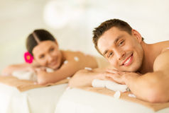 Couple in spa. Picture of couple in spa salon lying on the massage desks Stock Photography