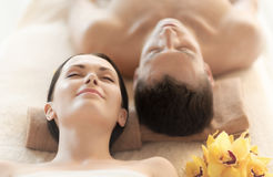 Couple in spa. Picture of couple in spa salon lying on the massage desks royalty free stock images