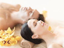 Couple in spa. Picture of couple in spa salon lying on the massage desks royalty free stock photography