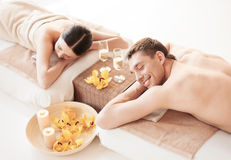 Couple in spa. Picture of couple in spa salon lying on the massage desks stock photos
