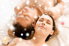 Couple in spa salon lying on the massage desks Royalty Free Stock Photography