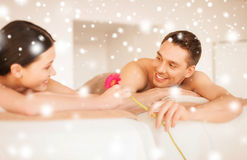 Couple in spa salon lying on the massage desks Royalty Free Stock Images