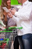 Couple Speaking while Shopping stock images