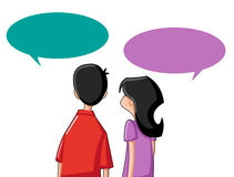 Couple with speech bubbles Royalty Free Stock Images