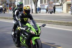 Couple speeding on motorbike Royalty Free Stock Photography