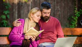 Couple spend leisure reading. Couple with book and laptop search information. Information source concept. Share or. Exchange information knowledge. Man and stock photo