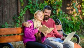 Couple spend leisure reading. Information source concept. Couple with book and laptop search information. Share or. Exchange information knowledge. Man and royalty free stock photography
