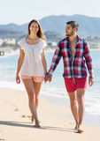 Couple spending free time at seaside Stock Image