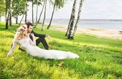 Couple spending honeymoon by the lakeside Stock Images