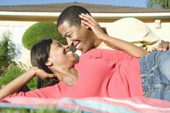 Couple Spending Leisure Time In Lawn. Romantic African American couple spending leisure time in lawn Stock Images