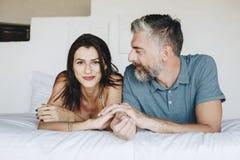 Couple spending their honeymoon in bed Stock Photos