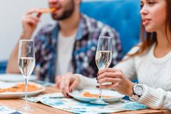 A couple spending time in a cafe eating an pizza and drinking champagne. royalty free stock photography