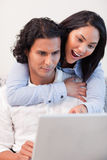 Couple spending time online together Stock Photography