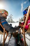 Couple spending time together and drink after skiing in ski reso Royalty Free Stock Images