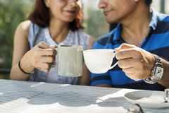 Couple spending time together having hot drink Stock Images