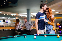 Couple spending time together by playing pool Stock Images