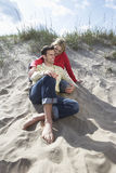 Couple Spending Time Together On Sandy Beach Royalty Free Stock Photo